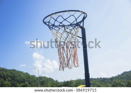 Old Netball ring with blue sky - stock photo