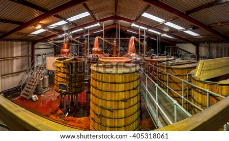 old new traditional distillery alcohol making facility wooden barrels cask interior  - stock photo