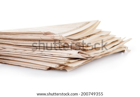 old newspapers isolated on a white background - stock photo