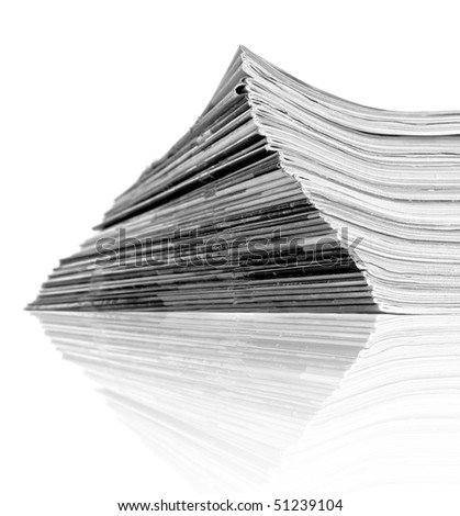 Old newspapers on a pile - stock photo