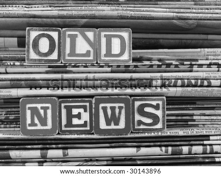 "Old newspapers stacked from the top to bottom filling the frame and ""Old News"" is written in Block Letters. B&W - stock photo"