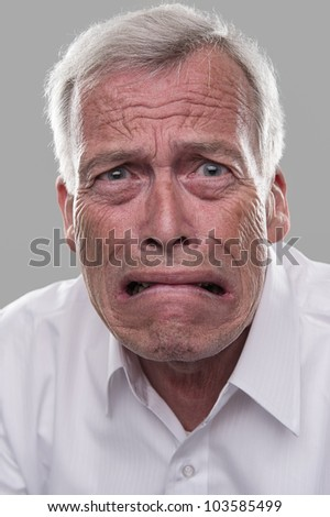 Old nice man scared witless. Afraid of retirement - stock photo