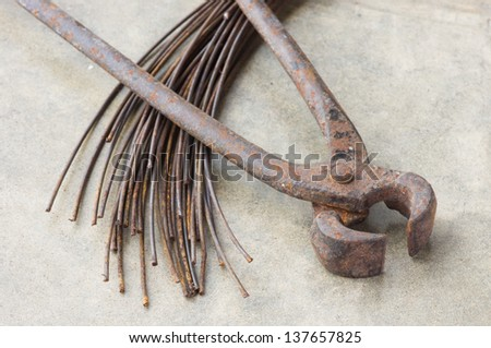 Old nippers or  pincers with metal wire - stock photo