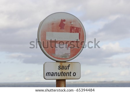 Old No entry traffic sign against cloudy sky - stock photo