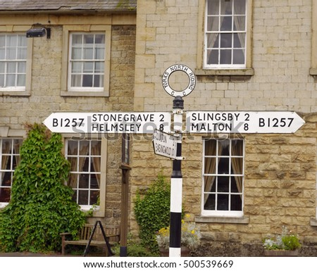 Old North Riding county road sign in the village of Hovingham in North Yorkshire, England