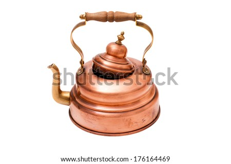 Old nostalgic copper tea pot with wooden handle isolated on white background - stock photo
