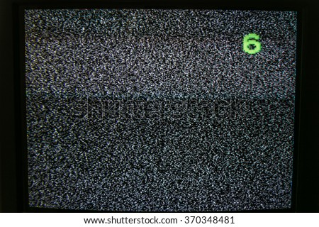 Old not working TV with nois - stock photo