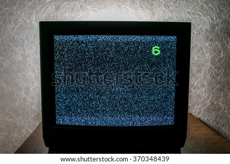 Old not working TV with noise - stock photo