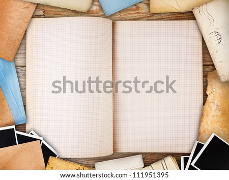 Old note book, paper and instant photos. Objects over old wood background - stock photo