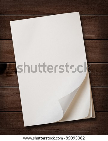 Old note paper block on wood background.