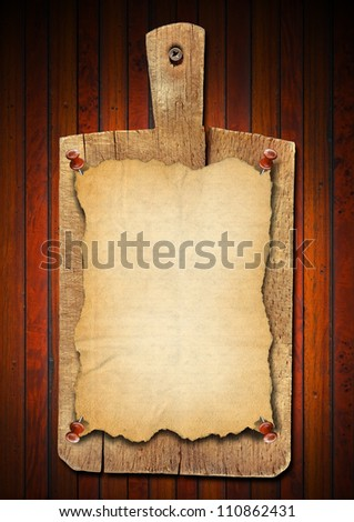 Old Notebook Cutting Board on Wood Background Notebooks for recipes or menu on used wooden cutting board - stock photo