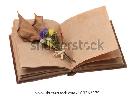 Old notebook open isolated on white background with flowers - stock photo