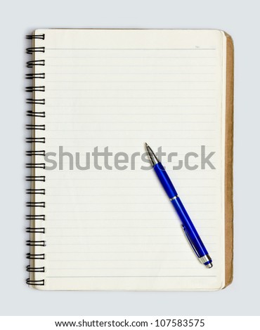 old notebook with pen - stock photo