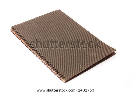 old notebook with spring closed on a white background - stock photo