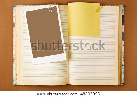 Old notebook with stained pages on brown paper surface. Useful for web site template - stock photo