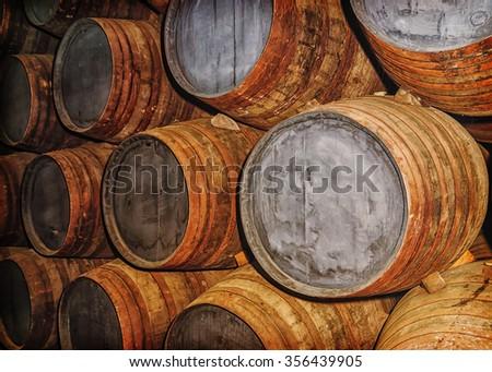 old oak barrels in the wine cellar - stock photo