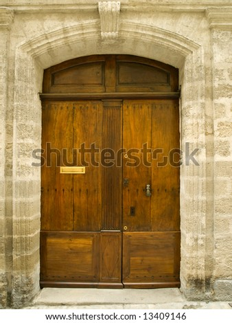 Old oak door with carved stone surround