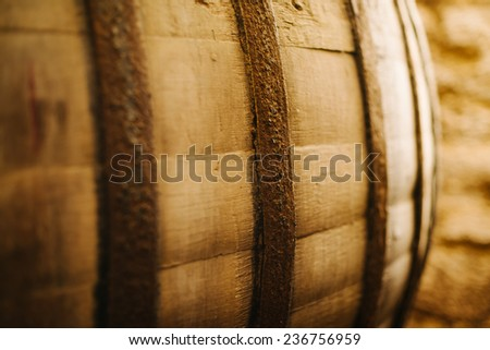 old oak wine barrel in the cellar - stock photo