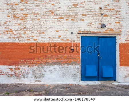 Old obsolete door and brick wall - stock photo