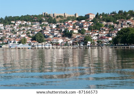 old Ohrid village and reflection on water lake, Republic of Macedonia - stock photo