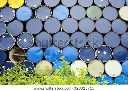 Old oil barrels stacked up / Oil barrels  - stock photo