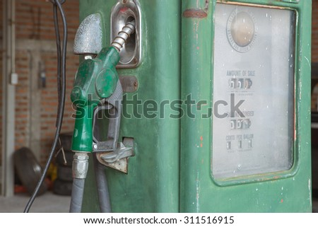 old oil gasoline dispenser - stock photo