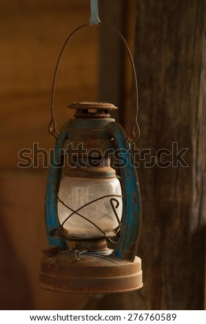 Old oil lamp in the yard - stock photo