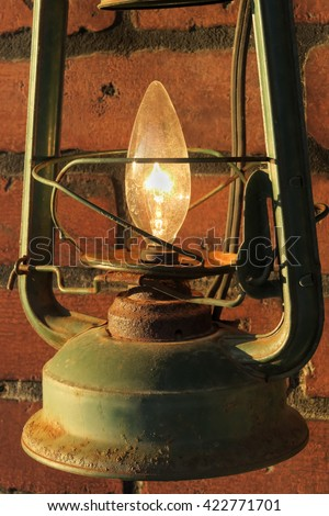 old oil lamp is now electric - stock photo