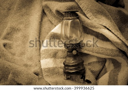 old oil lamp on fabric