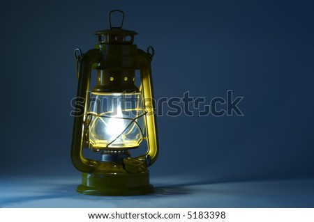 Old oil lantern in darkness. Light concept.
