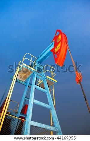 old oil pump jack - stock photo