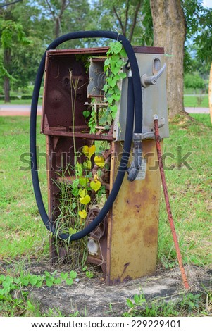 old oil pump side street. it can not use and have vine climbing - stock photo
