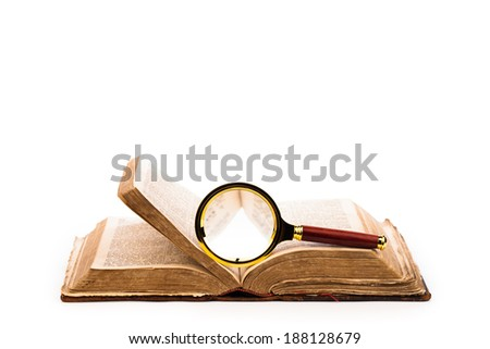 old open book and magnifying glass  - stock photo