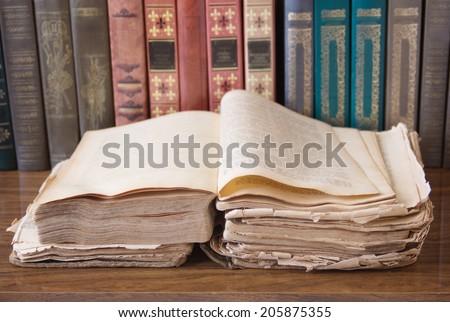 Old open book on bookshelf - stock photo