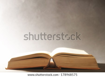 Old open book with bright light