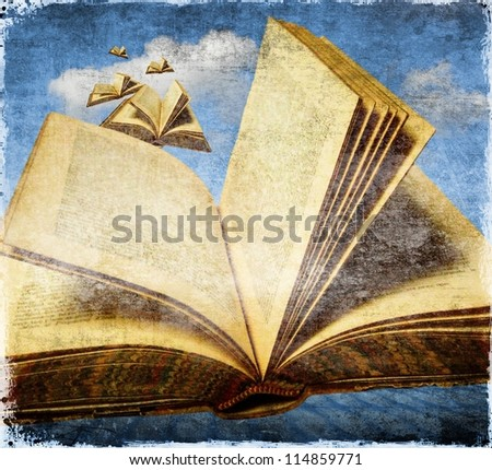 Old open books flying in the sky. Concept of freedom with reading. - stock photo