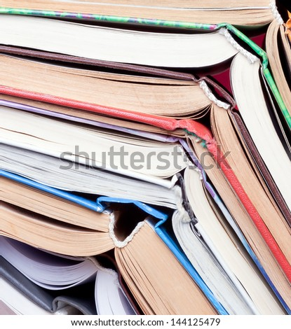 old open books stacked pile. background - stock photo