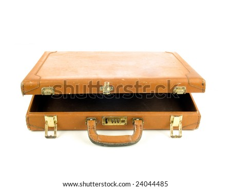 Old open briefcase isolated on white