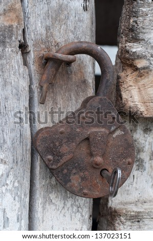 Old open padlock and key
