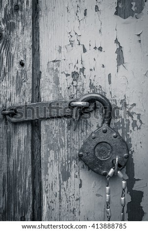 Old open padlock with key on a chain. - stock photo