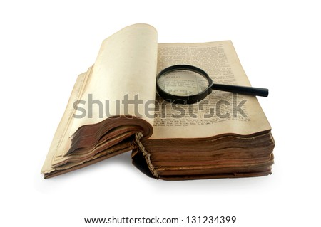 old open Russian bible with a magnifying glass isolated on white background - stock photo