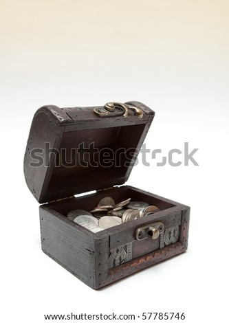 Old open treasure box with silver coins