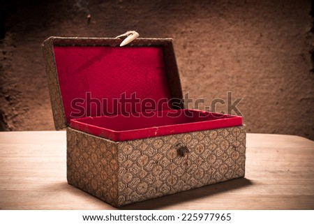 Old open vintage box with grunge background, still life. - stock photo