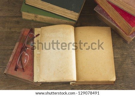 Old opened book with blank pages on wooden background. - stock photo