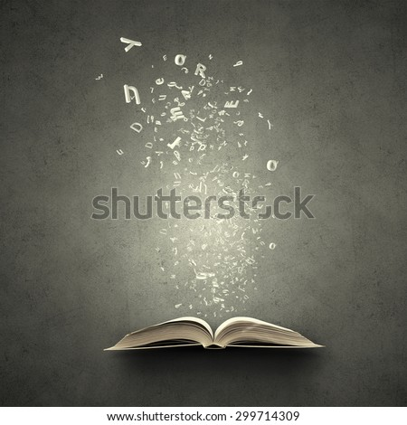 Old opened book with characters flying out of pages - stock photo