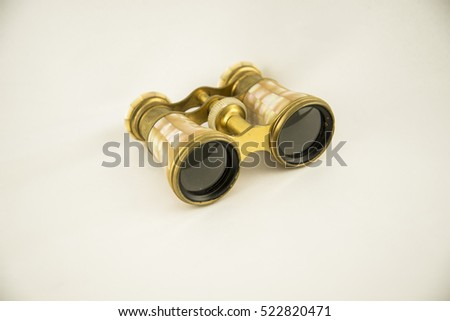 Old opera glasses isolated on a white background