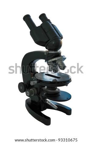 Old optical microscope isolated on white - stock photo