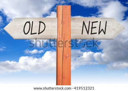 Old or new - wooden signpost