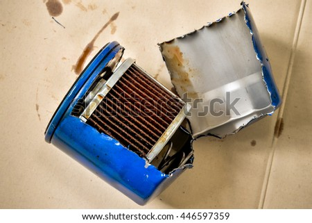 Old or used and dirty car oil filter, automotive maintenance service - stock photo