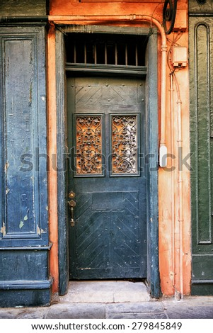 Old orange and green door in New Orleans French Quarter - stock photo
